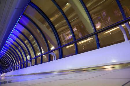 big windows in long corridor in modern building at night