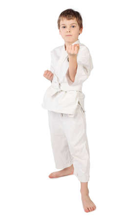 karateka: karateka boy in white kimono standing isolated on white background