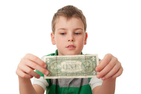 both: boy holds one dollar in both hands  isolated on white background, looking at dollar