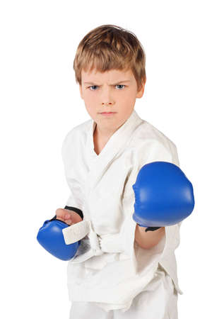 boy boxing: little boxer boy in white dress and blue boxing gloves fighting isolated on white Stock Photo