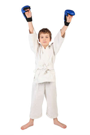 boy boxing: little boxer boy in white dress and blue boxing gloves hands up looking at camera