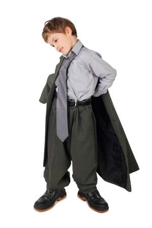 little boy in big grey mans suit and boots dressing jacket isolated on white background photo