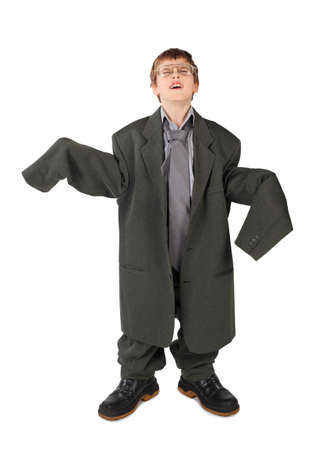 little boy in big grey mans suit, boots and glasses floor isolated on white background