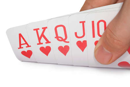 scarcity: playing cards of colour of hearts isolated on white background, royal flush of hearts, cards in human hand