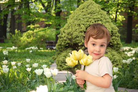 girl with yellow tulips in park, collage photo