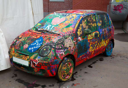 dirty car: Old car painted by multi-coloured drawings.
