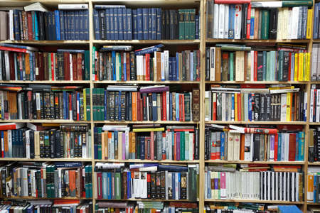 Private library. Wall from shelves filled with books. Editorial