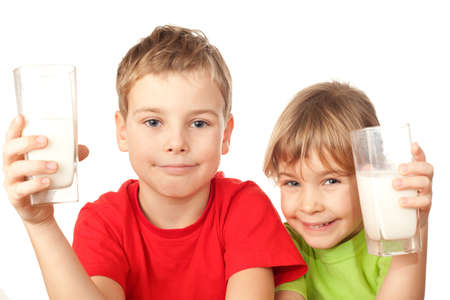 small nice girl and boy drink tasty fresh milk photo