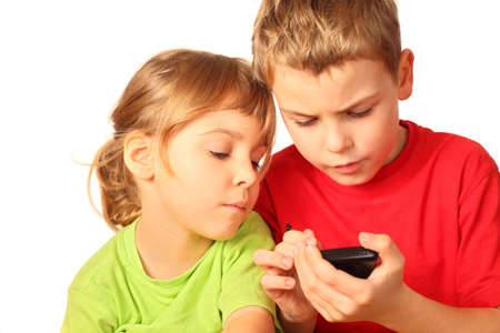 anything: small girl and boy search for anything interesting in smartphone