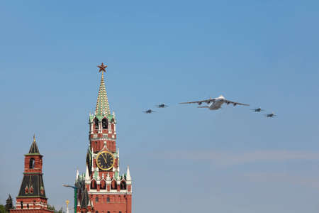 may 9: MOSCOW - MAY 9: An-124 and Su-27 airplanes fly over Red Square, Spasskaya Tower on parade in honor of Great Patriotic War victory on May 9, 2010 in Moscow, Russia
