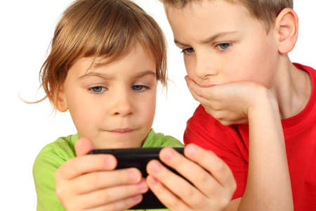 children found in telephone interesting game and they is very fascinated by it photo