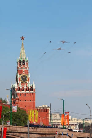 MOSCOW - MAY 9: Il-76, Tu-160 and Mig-29 airplanes fly over Red Square, Spasskaya Tower on parade in honor of Great Patriotic War victory on May 9, 2010 in Moscow, Russia