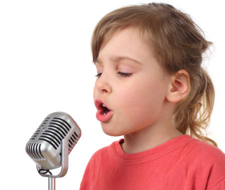 talent show: little girl in red shirt singing in microphone, half body, isolated
