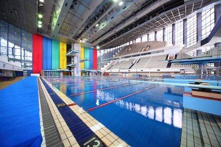 MOSCOW - OCTOBER 5: Large swimming pool with tribunes in sporting complex Olympic  on October 5, 2010 in Moscow , Russia. Water of pool Olympic acknowledged  specialists as one of most rapid in world.