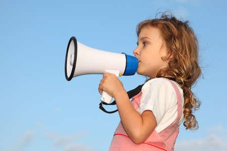 speaks: The lovely little girl, against the blue sky, speaks in a loudspeaker. Profile side.