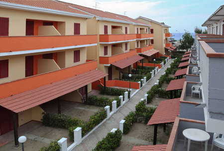 view of the resort on the coast. orange-storey villas with private balconies Stock Photo - 12512301