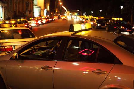 dublin ireland: city nightlife. few taxis wraps on road. Many bright lights