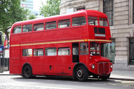 Empty red double-decker on street in London, England. Summer