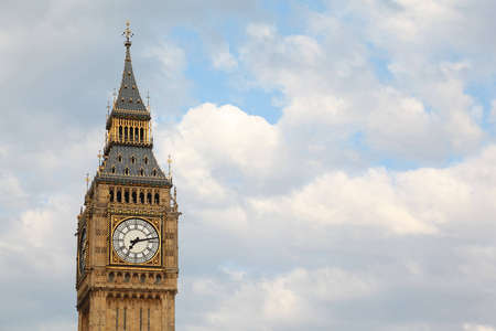 Big Ben is famous English clock chimes in Gothic style in London. Big Ben is one of Londons best-known landmarks  photo