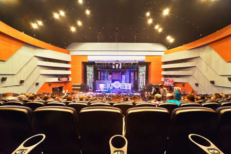music hall: MOSCOW – MARCH 27 : Concert hall with people during contest Hip Hop International - Cup Of Russia 2010, March 27 in Moscow, Russia.View on stage from hall end. Hall contains 923 armchairs, scene :depth - 10 meters, width - 22 m, height - 1,5 m. Editorial