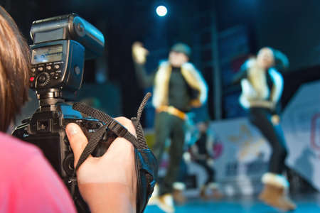 photographer shooting  dancers group on stage Stock Photo - 12512271