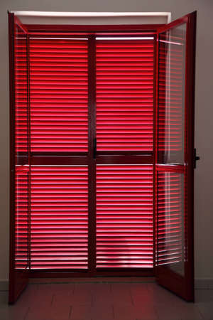 openly: Door on  verandah which is closed red jalousies Editorial