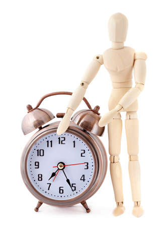 wooden mannequin: Wooden dummy with old-styled metal alarm clock.