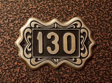 numerals: Close up shot of door with numerals 130.