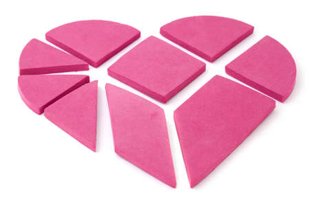 caoutchouc: The big pink heart broken into geometrical pieces.