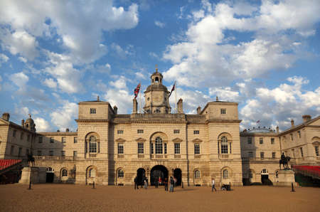 building of barracks of Royal Horse Guards in London. Tourists walk around it