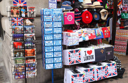 souvenir traditional: LONDON - JUNE 13: Postcards, t-shirts, hats, refrigerator magnets and other souvenirs on June 13, 2010 in London. Annually visitors spend in London 10 billion Pounds Sterling