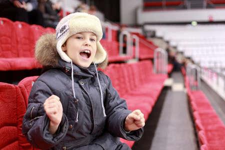 color fan: Boy loudly shouts on  hockey match