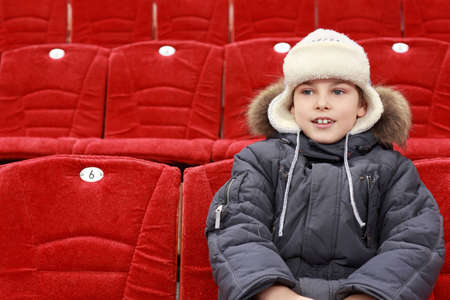 admirers: Boy sits in expectation of  hockey match