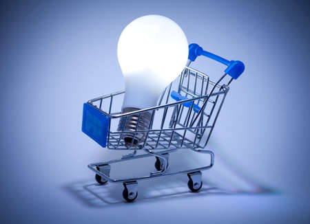Buy the Light. Shopping cart with light bulb. Stock Photo - 12511905