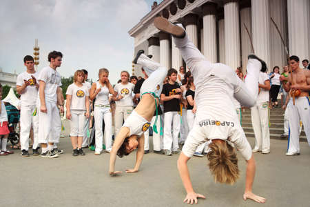 acrobatic: MOSCOW - MAY 15: Real capoeira performance at All-Russia Exhibition Center on May 15, 2010 in Moscow, Russia. Capoeira is an Afro-Brazilian art form that combines elements of martial arts, music, and dance Editorial
