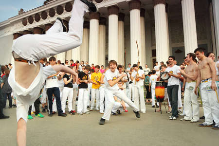MOSCOW - MAY 15: Two man dance on real capoeira performance at All-Russia Exhibition Center on May 15, 2010 in Moscow, Russia. Capoeira is an Afro-Brazilian material art