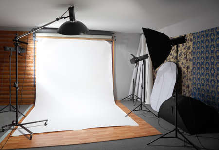 photo of accessories: White background inside studio - dark room lighted big lamps and spotlights Editorial