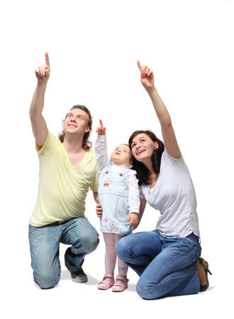 Happy mother, father and little daughter sit down and point fingers up Stock Photo - 12734214
