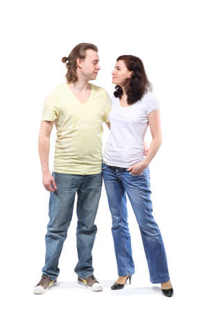 Young couple in jeans, boy and girl, are standing in embrace and looking at each other Stock Photo - 12734231
