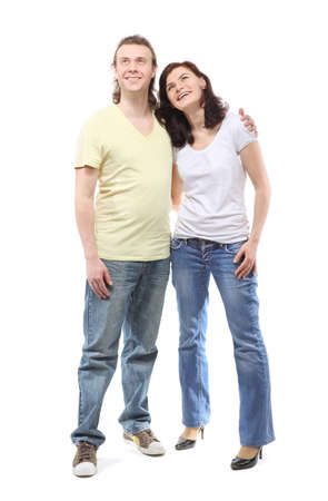Young couple in jeans, boy and girl, are standing in embrace and looking up Stock Photo - 12734234