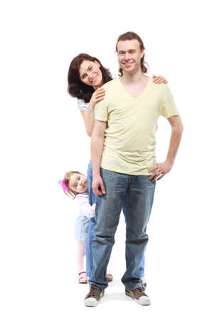 Young happy family -  mother, father and little daughter - are standing in embrace leaning on each other Stock Photo - 12734217