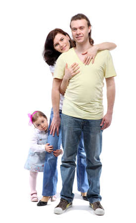 Young family -  mother, father and little daughter - are standing in embrace Stock Photo - 12734210