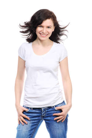 Beautiful brunette girl in jeans and white t-shirt is smile