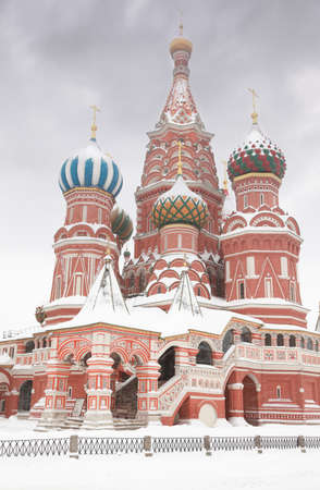 Enter to St. Basil Temple in Moscow, Russia at wintertime during snowfall