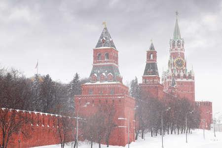 kremlin: Kremlin chiming clock of the Spasskaya Tower in Moscow, Russia at wintertime during snowfall