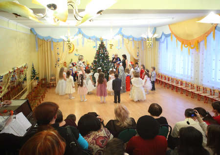 MOSCOW, RUSSIA - DECEMBER 29: Kids stand around Christmas tree in Kindergarten №1042 on December 29, 2010 in Moscow, Russia. In queue to kindergartens in Russia are about 2 million people in 2010.