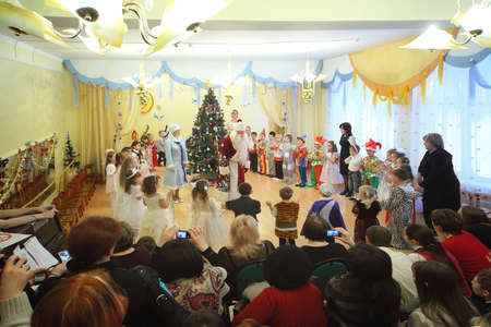 MOSCOW, RUSSIA - DECEMBER 29: Kids in costumes celebrate New Year in Kindergarten №1042 on December 29, 2010 in Moscow, Russia. In queue to kindergartens in Russia are about 2 million people in 2010. Stock Photo - 12512211
