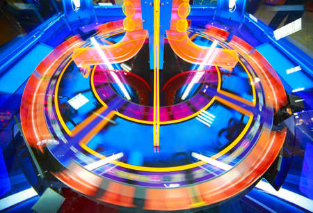 flaw: Close-up view of fast spinning yellow-blue electronic roulette