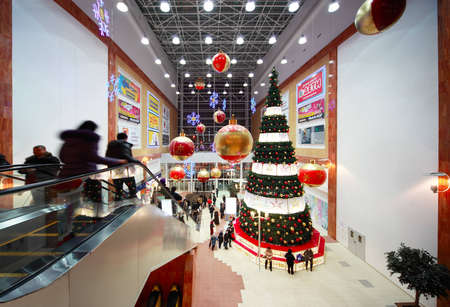 MOSCOW, RUSSIA - JANUARY 16: Christmas tree in center of hall inside shopping mall Golden Babylon on January 16, 2010 in Russia, Moscow. In 2003, it was voted the best shopping center in Russia.