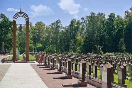 a memorial to fallen soldiers: Eternal flame, belfry and obelisks at the Military Memorial of the Preobrazhenskoye cemetery.